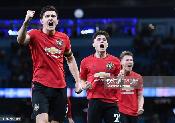 Harry Maguire and Daniel James of Manchester United celebrate following their sides victory during the Premier League match between Manchester City...