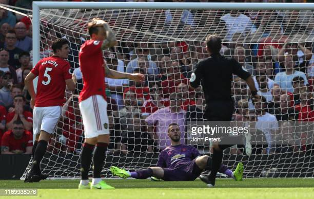 Harry Maguire and David de Gea of Manchester United react to conceding a goal to Jordan Ayew of Crystal Palace during the Premier League match...