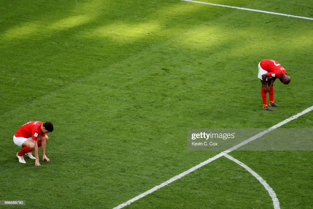 Harry Maguire and Fabian Delph of England look dejeceted after their side concede during the 2018 FIFA World Cup Russia 3rd Place Playoff match between Belgium and England at Saint Petersburg Stadium on July 14, 2018 in Saint Petersburg, Russia.