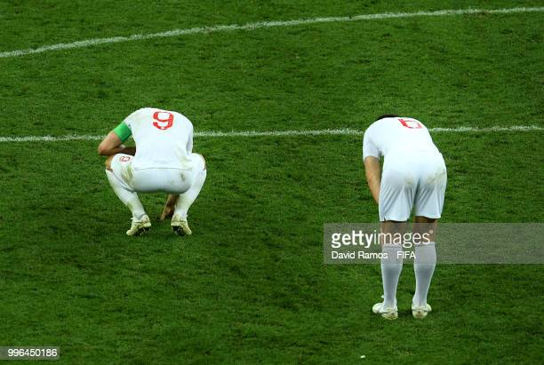 Harry Maguire and Harry Kane of England show their dejection following the 2018 FIFA World Cup Russia Semi Final match between England and Croatia at...