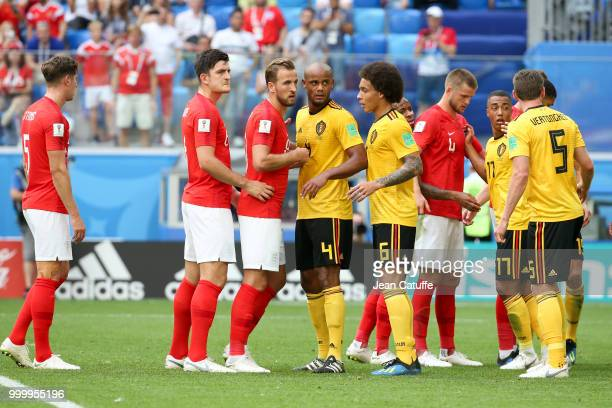 Harry Maguire and Harry Kane of England with Vincent Kompany and Axel Witsel of Belgium during the 2018 FIFA World Cup Russia 3rd Place Playoff match...