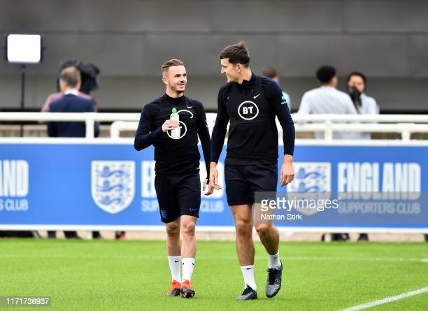 Harry Maguire and James Maddison make their way to training during an England Media Access day at St Georges Park on September 02 2019 in...