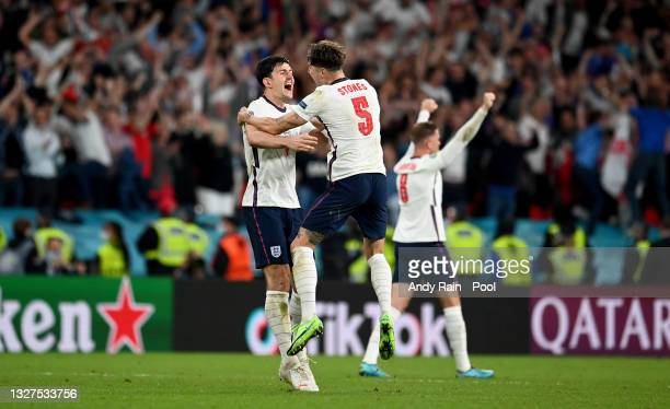 Harry Maguire and John Stones of England celebrate following their team's victory in the UEFA Euro 2020 Championship Semi-final match between England...