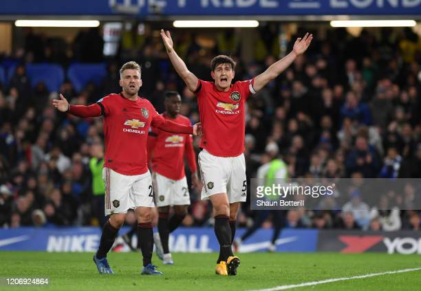 Harry Maguire and Luke Shaw of Manchester United reacts during the Premier League match between Chelsea FC and Manchester United at Stamford Bridge...