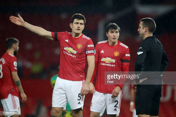 Harry Maguire and Victor Lindelof of Manchester United confront referee David Coote after he makes the decision to award West Bromwich Albion a...
