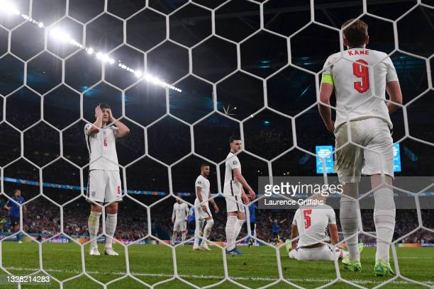 Harry Maguire, Declan Rice, John Stones and Harry Kane of England look dejected after conceding during the UEFA Euro 2020 Championship Final between...