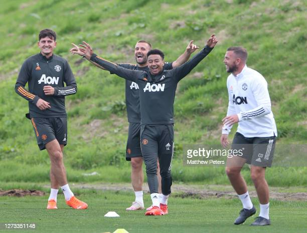 Harry Maguire Luke Shaw Jesse Lingard of Manchester United in action during a first team training session at Aon Training Complex on September 18...
