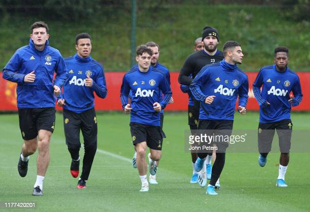 Harry Maguire Mason Greenwood Daniel James Juan Mata Luke Shaw Andreas Pereira Fred of Manchester United in action during a first team training...