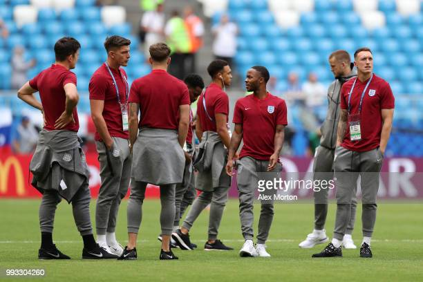 Harry Maguire Nick Pope Raheem Sterling and Phil Jones of England looks on during pitch inspection prior to the 2018 FIFA World Cup Russia Quarter...