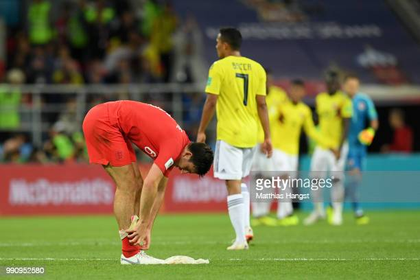 Harry Maguire of England adjusts his socks at end of the game before extra time during the 2018 FIFA World Cup Russia Round of 16 match between...
