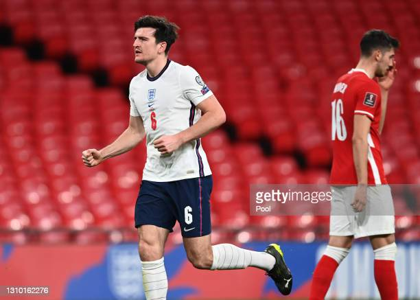 Harry Maguire of England celebrates after scoring their side's second goal during the FIFA World Cup 2022 Qatar qualifying match between England and...