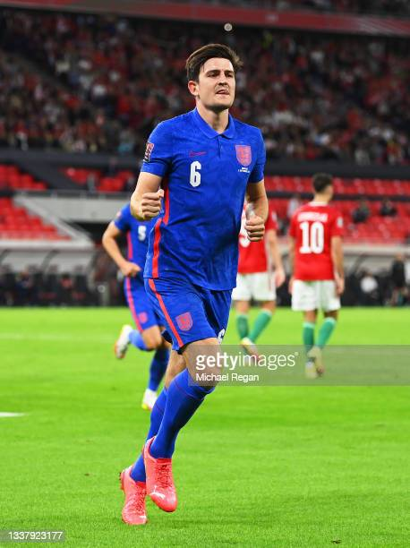 Harry Maguire of England celebrates after scoring their team's third goal during the 2022 FIFA World Cup Qualifier match between Hungary and England...