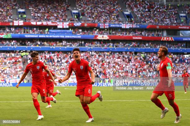 Harry Maguire of England celebrates scoring a goal to make it 01 with John Stones and Harry Kane during the 2018 FIFA World Cup Russia Quarter Final...