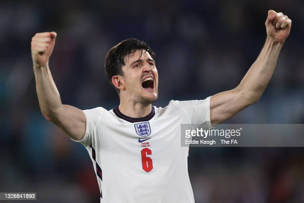 Harry Maguire of England celebrates their side's victory towards the fans after the UEFA Euro 2020 Championship Quarter-final match between Ukraine...