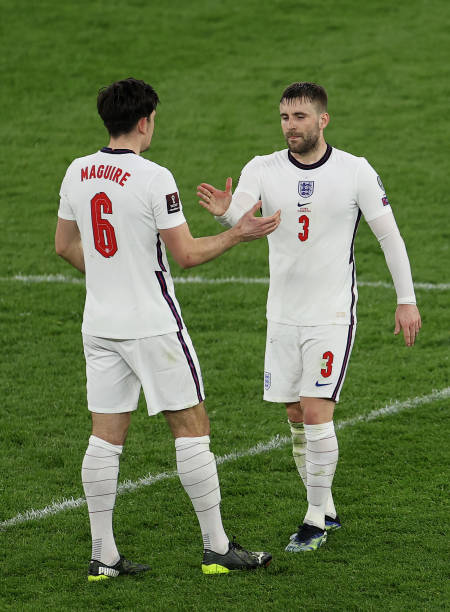 Harry Maguire of England celebrates victory with team mate Luke Shaw following the FIFA World Cup 2022 Qatar qualifying match between Albania and...