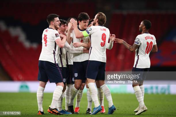 Harry Maguire of England celebrates with Declan Rice, Harry Kane and Raheem Sterling after scoring their side's second goal during the FIFA World Cup...