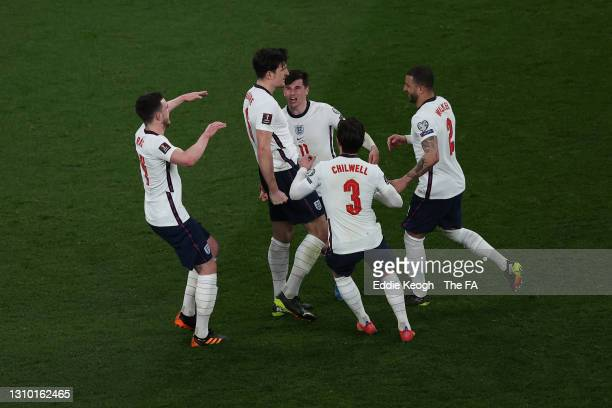 Harry Maguire of England celebrates with Declan Rice, Mason Mount, Ben Chilwell and Kyle Walker after scoring their side's second goal during the...