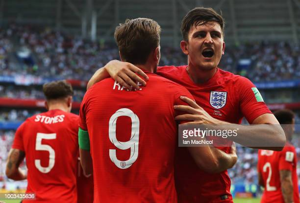 Harry Maguire of England celebrates with harry Kane after he scores during the 2018 FIFA World Cup Russia Quarter Final match between Sweden and...