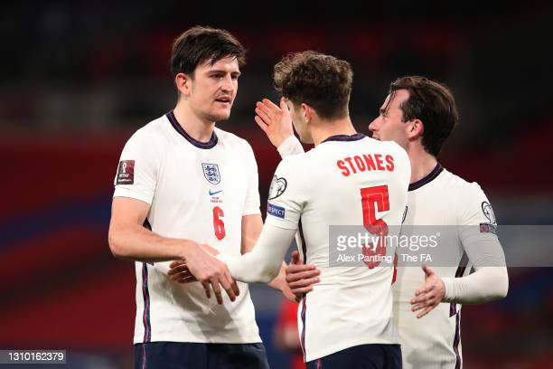 Harry Maguire of England celebrates with John Stones after scoring their side's second goal during the FIFA World Cup 2022 Qatar qualifying match...