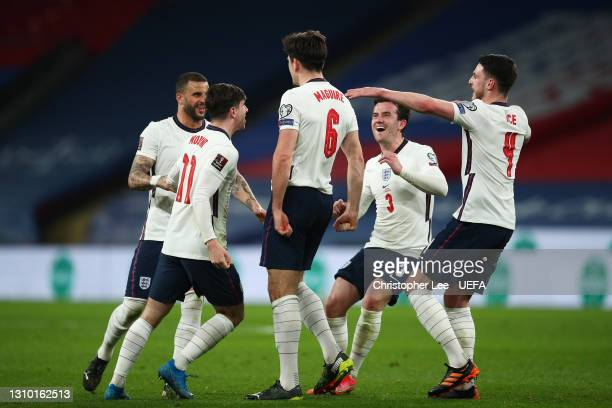Harry Maguire of England celebrates with Kyle Walker, Mason Mount, Ben Chilwell and Declan Rice after scoring their side's second goal during the...
