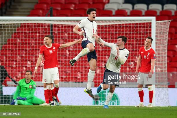 Harry Maguire of England celebrates with Mason Mount after scoring their side's second goal during the FIFA World Cup 2022 Qatar qualifying match...