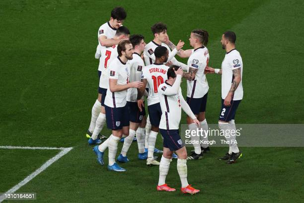 Harry Maguire of England celebrates with team mates after scoring their side's second goal during the FIFA World Cup 2022 Qatar qualifying match...