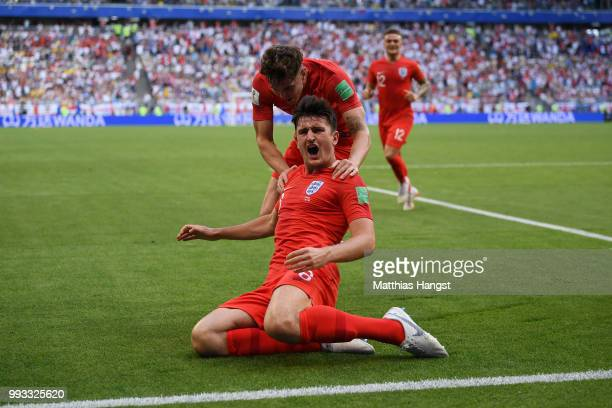 Harry Maguire of England celebrates with teammate John Stones after scoring his team's first goal during the 2018 FIFA World Cup Russia Quarter Final...