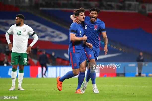 Harry Maguire of England celebrates with Tyrone Mings of England after he scores his sides first goal during the international friendly match between...
