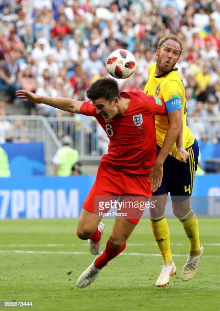 Harry Maguire of England is challenged by Andreas Granqvist of Sweden during the 2018 FIFA World Cup Russia Quarter Final match between Sweden and...