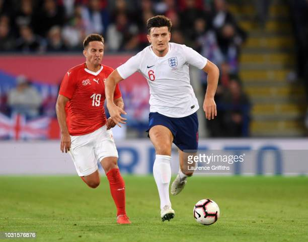 Harry Maguire of England is chased by Mario Gavranovic of Switzerland during the international friendly match between England and Switzerland at The...