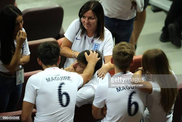 Harry Maguire of England is consoled by family and friends following the 2018 FIFA World Cup Russia Semi Final match between England and Croatia at...