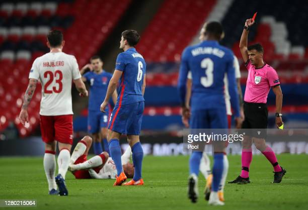 Harry Maguire of England is shown the red card by match referee Jesus Gil Manzano after getting a second yellow card during the UEFA Nations League...