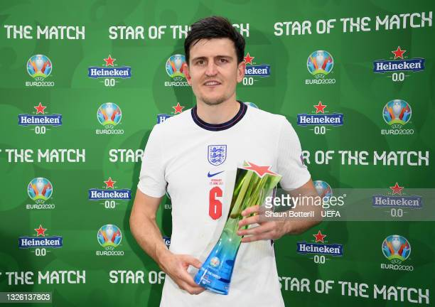 """Harry Maguire of England poses for a photograph with their Heineken """"Star of the Match"""" award after the UEFA Euro 2020 Championship Round of 16 match..."""