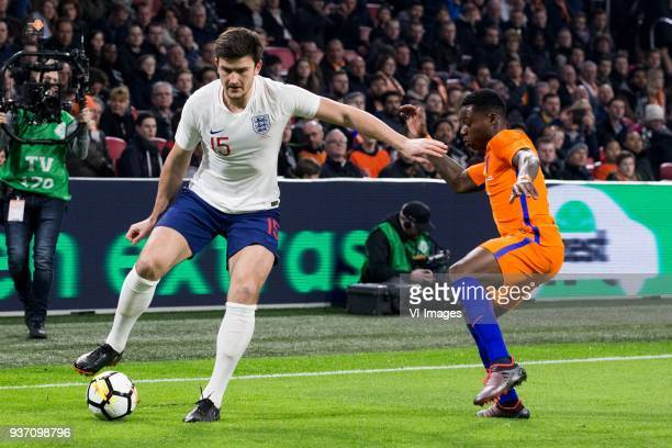 Harry Maguire of England Quincy Promes of Holland during the International friendly match match between The Netherlands and England at the Amsterdam...