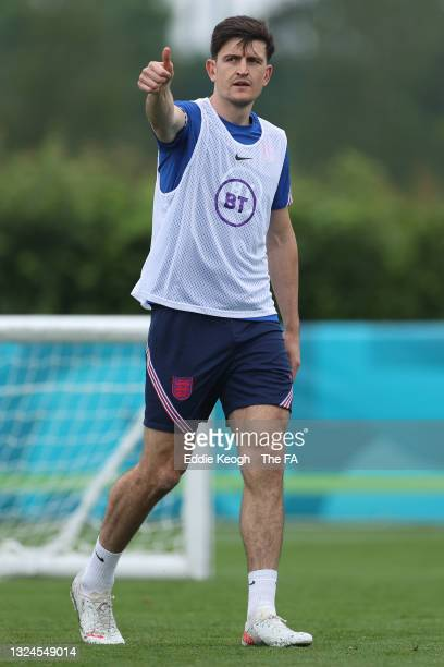 Harry Maguire of England reacts during the England Training Session at Tottenham Hotspur Training Ground on June 20, 2021 in Burton upon Trent,...