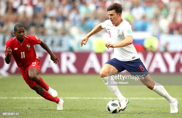 Harry Maguire of England runs with the ball at Armando Cooper of Panama during the 2018 FIFA World Cup Russia group G match between England and...