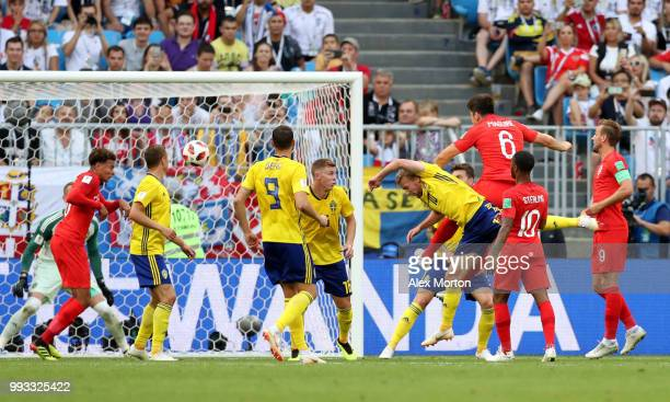 Harry Maguire of England scores his team's first goal during the 2018 FIFA World Cup Russia Quarter Final match between Sweden and England at Samara...