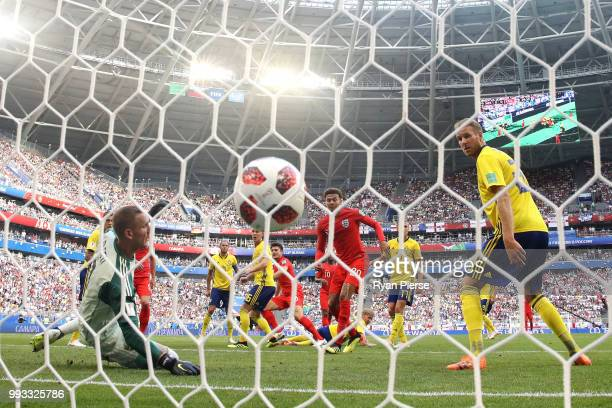 Harry Maguire of England scores his team's first goal past Robin Olsen of Sweden during the 2018 FIFA World Cup Russia Quarter Final match between...