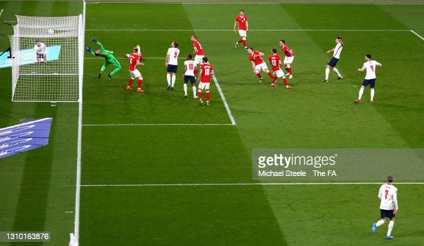Harry Maguire of England scores their side's second goal past Wojciech Szczesny of Poland during the FIFA World Cup 2022 Qatar qualifying match...