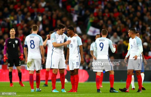 Harry Maguire of England speaks to Marcus Rashford of England during the international friendly match between England and Brazil at Wembley Stadium...