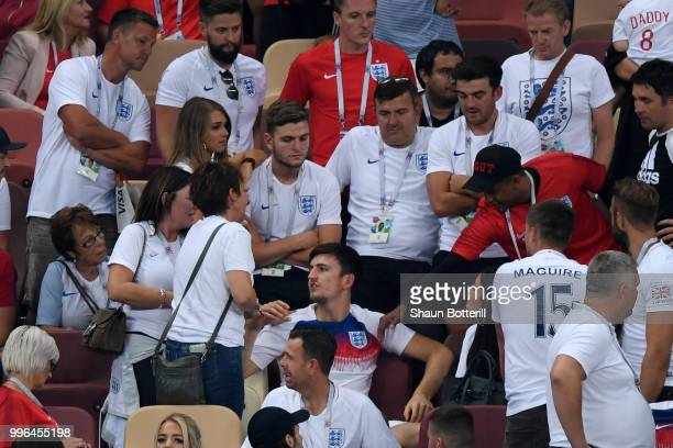 Harry Maguire of England speaks with his family as he looks dejected following his sides defeat in the 2018 FIFA World Cup Russia Semi Final match...
