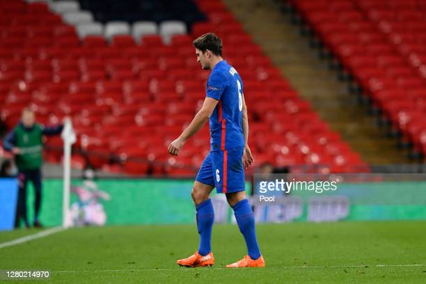 Harry Maguire of England walks off the pitch after being shown the red card by match referee Jesus Gil Manzano after getting a second yellow card...