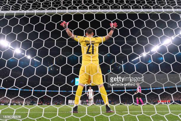 Harry Maguire of England walks up to take his penalty as in a penalty shoot out as Gianluigi Donnarumma of Italy looks on during the UEFA Euro 2020...