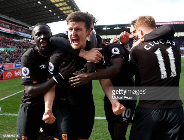 Harry Maguire of Hull City celebrates scoring his sides first goal with his Hull City team mates during the Premier League match between Stoke City...