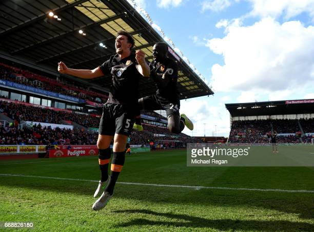 Harry Maguire of Hull City celebrates scoring his sides first goal with Oumar Niasse of Hull City during the Premier League match between Stoke City...