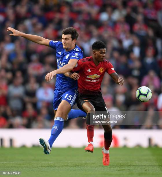 Harry Maguire of Leicester City and Marcus Rashford of Manchester United collide during the Premier League match between Manchester United and...