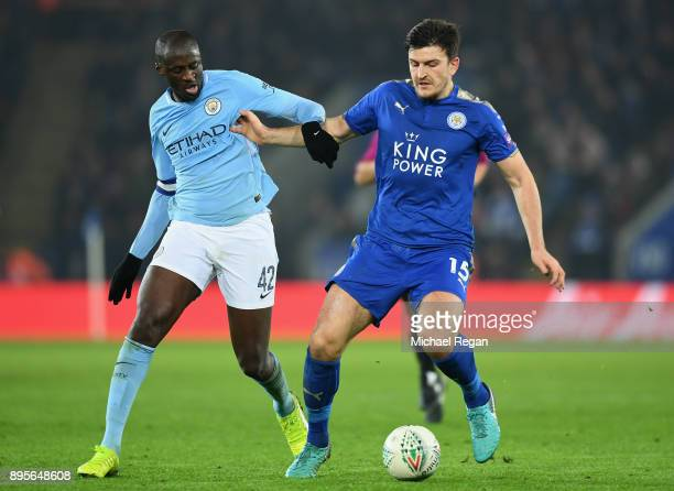 Harry Maguire of Leicester City and Yaya Toure of Manchester City battle for the ball during the Carabao Cup QuarterFinal match between Leicester...
