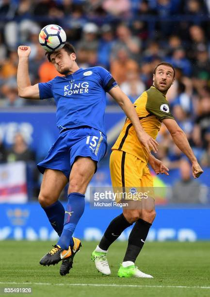 Harry Maguire of Leicester City battle for possession with Glenn Murray of Brighton and Hove Albion in the air during the Premier League match...