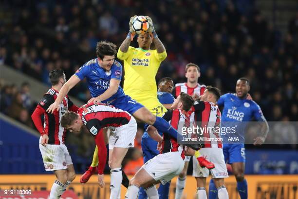 Harry Maguire of Leicester City battles with John Lundstram of Sheffield United and Jamal Blackman of Sheffield United during the Emirates FA Cup...