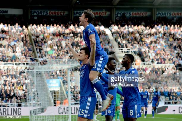 Harry Maguire of Leicester City celebrates with Ben Chilwell after scoring his sides second goal during the Premier League match between Newcastle...
